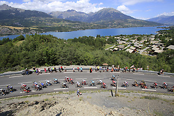 The 50+ breakaway group start to climb Cote de Demoiselles Coiffees at Lac de Serre-Poncon during Stage 18 of the 104th edition of the Tour de France 2017, running 179.5km from Briancon to the summit of Col d'Izoard, France. 20th July 2017.<br /> Picture: Eoin Clarke | Cyclefile<br /> <br /> All photos usage must carry mandatory copyright credit (© Cyclefile | Eoin Clarke)