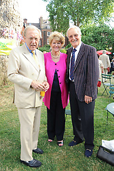 Left to right, SIR DAVID FROST and NICHOLAS & ANNIE PARSONS at the Lord's Taverners Diamond Jubilee Garden Party held in College Gardens, Westminster Abbey, London on 8th July 2010.