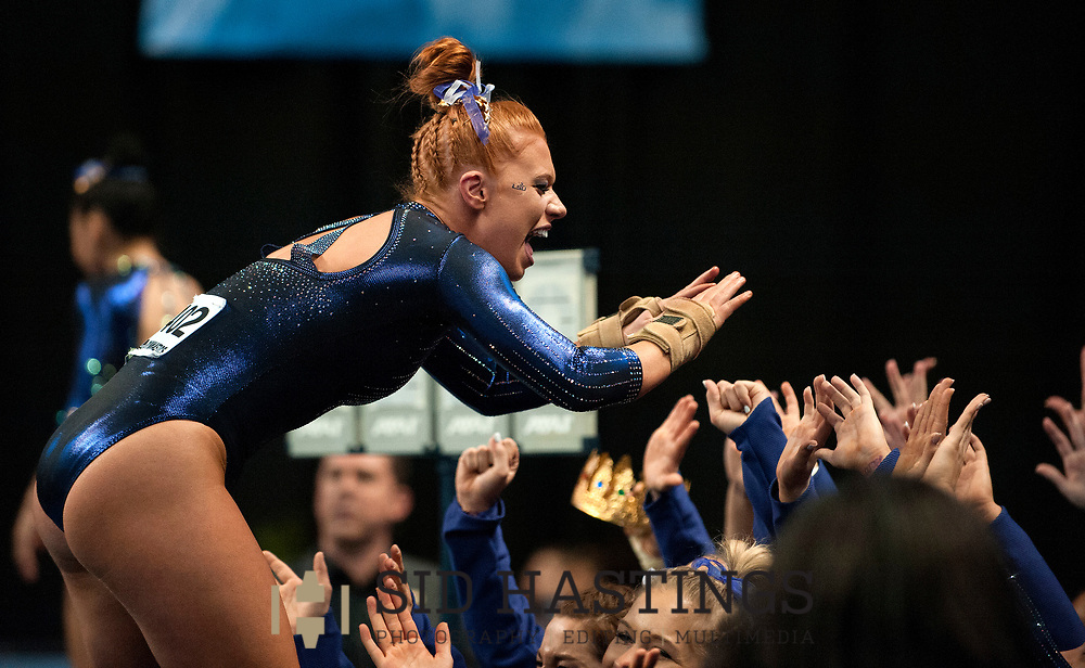 21 APRIL 2018 -- ST. LOUIS -- LSU gymnast Julianna Cannamela is congratulated by her teammates after competing in the Vault during the 2018 NCAA Women's Gymnastics Championship Super Six at Chaifetz Arena in St. Louis Saturday, April 21, 2018. The Tigers finished fourth in the nation during the meet.<br /> Photo &copy; copyright 2018 Sid Hastings.