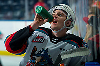 KELOWNA, BC - FEBRUARY 28: Forward Jake Lee #21 of the Kelowna Rockets stands at the bench during warm up to re-hydrate against the Everett Silvertips at Prospera Place on February 28, 2020 in Kelowna, Canada. (Photo by Marissa Baecker/Shoot the Breeze)