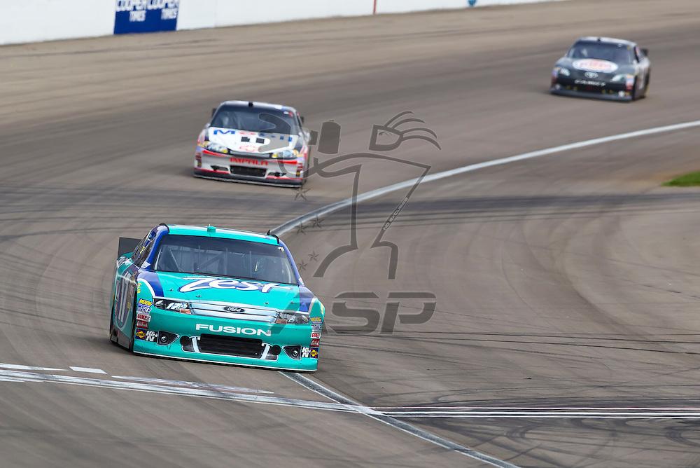 LAS VEGAS, NV - MAR 11, 2012:  Matt Kenseth (17) and Tony Stewart (14) battle for position during the Kobalt Tools 400 race at the Las Vegas Motor Speedway in Las Vegas, NV.