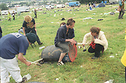Ravers improvising for musical sounds,Glastonbury,1994.