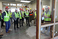 Cedar Rapids City Council members and Linn County Supervisors look at offices for Chief Justice Linda Reade during a tour of the new Federal Courthouse in Cedar Rapids on Tuesday morning, April 10, 2012. (Stephen Mally/Freelance)