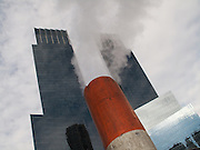 Looking up at steam coming from a pipe near the twin towers of the Time Warner Center at Columbus Circle in Manhattan