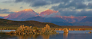 Panorama of alpenglow on mountains at sunrise over tufa on the South Shore of Mono Lake, Mono County, Eastern Sierra, California