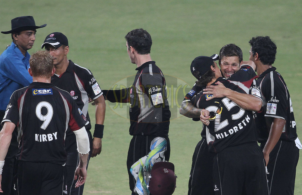 Peter Trego of Somerset and James Hildreth of Somerset celebrate after beating Warriors to reach the semi finals during match 19 of the NOKIA Champions League T20 ( CLT20 )between the Warriors and Somerset held at the  M.Chinnaswamy Stadium in Bangalore , Karnataka, India on the 5th October 2011..Photo by Shaun Roy/BCCI/SPORTZPICS