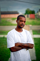 29 August 2014. Lower 9th Ward, New Orleans, Louisiana.<br /> Hurricane Katrina memorial 9 years later. <br /> Juan Seaton, a Katrina survivor reflects on how he and his family survived the storm on the 9th anniversary.<br /> Photo; Charlie Varley/varleypix.com