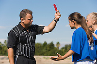 Soccer Referee Ejecting Player with Red Card