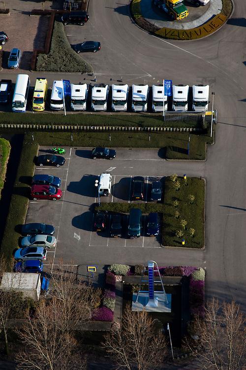 Nederland, Zuid-Holland, Nieuwerkerk aan den IJssel, 20-03-2009; het laagste punt van Nederland, 6.76 m beneden Normaal Amsterdams Peil (NAP), ligt in de Zuidplaspolder  op het terrein van Van Vliet Trucks. Dit automobielbedrijf heeft een monument - in de vorm van een pijlschaal - neer laten zetten.  A monument of the lowest point of the Netherlands, 6.76 m below Normal Amsterdam Level (NAP), has been placed by a car company next to the cycle track..Swart collectie, luchtfoto (toeslag); Swart Collection, aerial photo (additional fee required).foto Siebe Swart / photo Siebe Swart