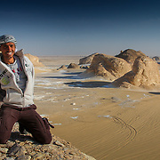 Egyptian man in spectacular desert landscape, Egypt (January 2008)