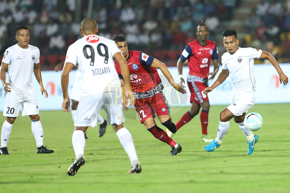 NorthEast United FC and  Jamshedpur FC players  fight for ball during match 2 of the Hero Indian Super League between NorthEast United FC and Jamshedpur FC held at the Indira Gandhi Athletic Stadium, Guwahati India on the 18th November 2017<br /> <br /> Photo by: Arjun Singh  / ISL / SPORTZPICS