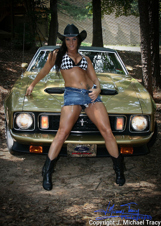 Gorgeous Cowgirl Model posing with gorgeous 1973 Ford Mustang Mach 1.