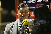 Whitehawk Manager Steve King after the game being interviewed during the The FA Cup 2nd Round Replay match between Whitehawk FC and Dagenham and Redbridge at the Enclosed Ground, Whitehawk, United Kingdom on 16 December 2015. Photo by Phil Duncan.