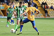 George Francomb of AFC Wimbledon and Malvind Benning battle during the Sky Bet League 2 match between Mansfield Town and AFC Wimbledon at the One Call Stadium, Mansfield, England on 5 September 2015. Photo by Stuart Butcher.