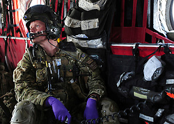 © London News Pictures. 11/06/11. AFGHANISTAN.  Flight Sergeant (FS) Tony Kyle is the emergency department nurse and he is also responsible for listening to the troops on the ground and the aircrew as they make an assessment where the safest place will be to land, which is particularly important when there is still a conflict on the ground. The RAF Regiment's Medical Emergency Response Team (MERT) is made up of two teams based in 'Main Operating Base Bastion', they are responsible for extracting casualties from anywhere within Helmand Province.  The MERT consists of a doctor, an emergency department nurse and two paramedics.  In addition four Royal Air Force Regiment gunners provide armed protection when they land and leave the helicopter to collect the casualty.   Caption must read Alison Baskerville/LNP...