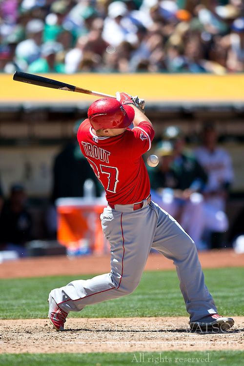 OAKLAND, CA - JUNE 21:  Mike Trout #27 of the Los Angeles Angels of Anaheim is hit by a foul tip during the sixth inning against the Oakland Athletics at O.co Coliseum on June 21, 2015 in Oakland, California. The Oakland Athletics defeated the Los Angeles Angels of Anaheim 3-2. (Photo by Jason O. Watson/Getty Images) *** Local Caption *** Mike Trout