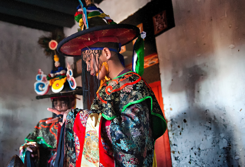 Monks prepare to dance in costume at the Black Hat festival in Bumthang, Bhutan.