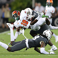 ORLANDO, FL - AUGUST 29: Xavier Smith #19 of the Florida A&M Rattlers gets tripped up by Nate Evans #44 and Antwan Collier #3 of the UCF Knights during a NCAA football game on August 29 2019 in Orlando, Florida. (Photo by Alex Menendez/Getty Images) *** Local Caption *** Xavier Smith; Nate Evans; Antwan Collier
