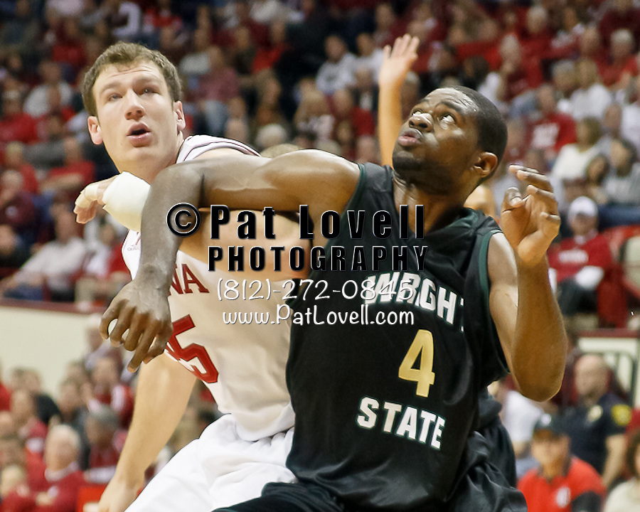 Indiana Hoosiers forward Tom Pritchard (25) and Wright State Raiders forward Johann Mpondo (4) battle for a rebound in an NCAA game at Assembly Hall in Bloomington on 11-14-10