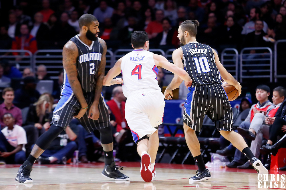 03 December 2014: Orlando Magic guard Evan Fournier (10) drives past Los Angeles Clippers guard J.J. Redick (4) on a screen set by Orlando Magic forward Kyle O'Quinn (2) during the Los Angeles Clippers 114-86 victory over the Orlando Magic, at the Staples Center, Los Angeles, California, USA.