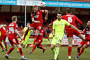 Crawley Town Forward Matt Harrold (18) heads clear from a corner during the Sky Bet League 2 match between Crawley Town and Hartlepool United at the Checkatrade.com Stadium, Crawley, England on 19 March 2016. Photo by Andy Walter.