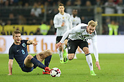 Eric Dier of England and Julian Brandt of Germany battle during the International Friendly match between Germany and England at Signal Iduna Park, Dortmund, Germany on 22 March 2017. Photo by Phil Duncan.