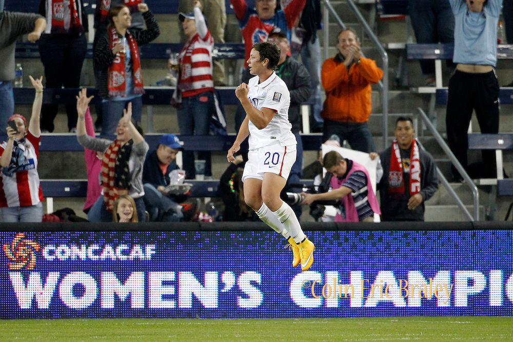 USA's Abby Wambach celebrates her goal against Trinidad during the second half of the CONCACAF Women's Championship Wednesday, Oct. 15, 2014, in Kansas City, Kan.(AP Photo/Colin E. Braley)