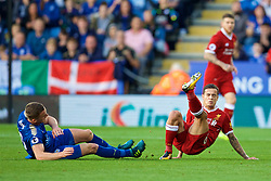 LEICESTER, ENGLAND - Saturday, September 23, 2017: Liverpool's Philippe Coutinho Correia is tackled by Leicester City's Andy King during the FA Premier League match between Leicester City and Liverpool at the King Power Stadium. (Pic by David Rawcliffe/Propaganda)