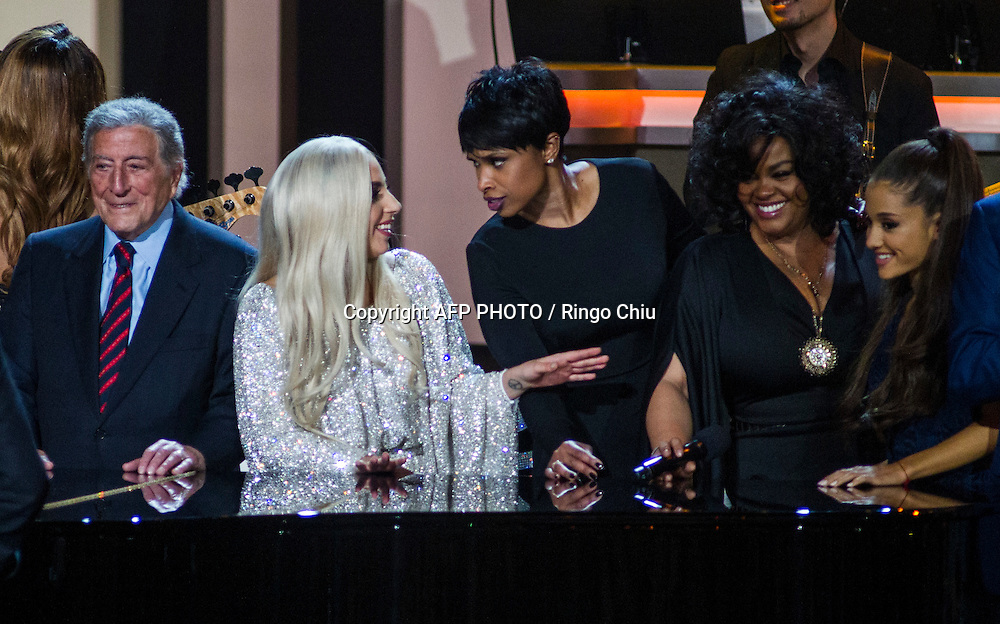 From left to right, Tony Bennett, Lady Gaga, Jennifer Hudson and Jill Scott onstage during the finale of the concert, Stevie Wonder: Songs In The Key Of Life - An All-Star GRAMMY Salute, at Nokia Theatre L.A. Live on February 10, 2015 in Los Angeles, California. AFP PHOTO / Ringo Chiu