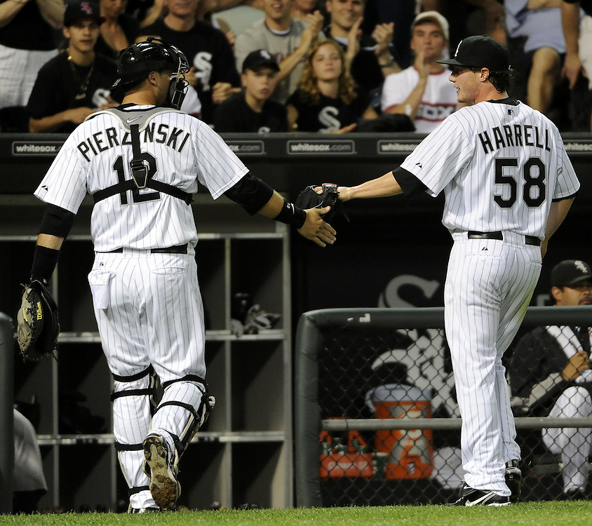 CHICAGO - JULY 30:  Lucas Harrell #58 is congratulated by A.J. Pierzynski #12 of the Chicago White Sox during the game against the Oakland Athletics on July 30, 2010 at U.S. Cellular Field in Chicago, Illinois.  Harrell was making his major league debut.  The White Sox defeated the Athletics 6-1.  (Photo by Ron Vesely)