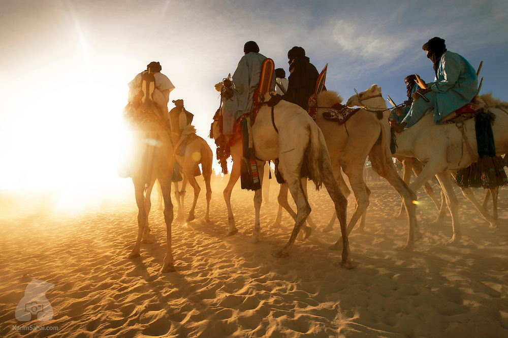 Tuareg camel riders in the Sahara desert at sunrise, Timbuktu, Mali.