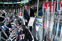 KELOWNA, CANADA - OCTOBER 23: Brad Ralph, head coach of the Kelowna Rockets runs through a play on the bench against the Prince George Cougars on October 23, 2015 at Prospera Place in Kelowna, British Columbia, Canada.  (Photo by Marissa Baecker/Shoot the Breeze)  *** Local Caption *** Brad Ralph;