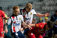 GOSFORD, AUSTRALIA - OCTOBER 02: Central Coast Mariners forward Matthew Simon (19) and Adelaide United midfielder Ryan Strain (4) fight for the ball during the FFA Cup Semi-final football match between Central Coast Mariners and Adelaide United on October 02, 2019 at Central Coast Stadium in Gosford, Australia. (Photo by Speed Media/Icon Sportswire)