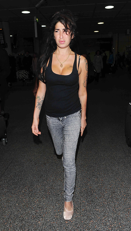 05.DECEMBER.2010. LONDON<br /> <br /> AMY WINEHOUSE ARRIVING BACK AT LONDON GATWICK AIRPORT AFTER FLYING IN FROM BARBADOS.<br /> <br /> BYLINE: OPTICPHOTOS.COM<br /> <br /> *THIS IMAGE IS STRICTLY FOR UK NEWSPAPERS AND MAGAZINES ONLY*<br /> *FOR WORLD WIDE SALES AND WEB USE PLEASE CONTACT OPTICPHOTOS - 0208 954 5968*