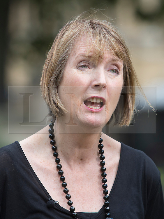 © Licensed to London News Pictures. 29/07/2015. City, UK.  Acting Leader of the Labour Party Harriet Harman speaks to a TV crew outside Westminster Palace on the migration crisis in the French port town of Calais. Photo credit : LNP