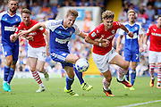 Barnsley forward Tom Bradshaw turns during the EFL Sky Bet Championship match between Ipswich Town and Barnsley at Portman Road, Ipswich, England on 6 August 2016. Photo by Nigel Cole.
