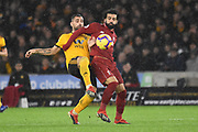 Wolverhampton Wanderers Johnny Otto battles with Liverpool forward Mohamed Salah during the Premier League match between Wolverhampton Wanderers and Liverpool at Molineux, Wolverhampton, England on 21 December 2018.
