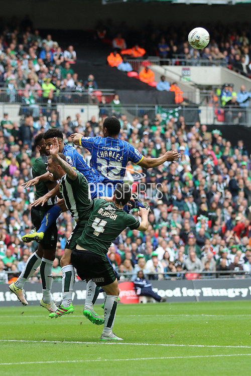 Lyle Taylor forward for AFC Wimbledon (33) and Darius Charles defender for AFC Wimbledon (32) during the Sky Bet League 2 play off final match between AFC Wimbledon and Plymouth Argyle at Wembley Stadium, London, England on 30 May 2016. Photo by Stuart Butcher.