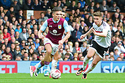 Aston Villa midfielder Jack Grealish (40) pulls away from Fulham midfielder Tom Cairney (10) during the EFL Sky Bet Championship match between Fulham and Aston Villa at Craven Cottage, London, England on 17 April 2017. Photo by Jon Bromley.