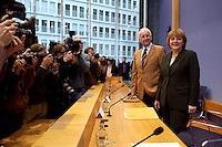 15 NOV 2004, BERLIN/GERMANY:<br /> Edmund Stoiber (L), CSU, Ministerpraesident Bayern, und Angela Merkel (R), CDU Bundesvorsitzende, Fotojournalisten und Kameraleute, vor Beginn einer Pressekonferenz zur Reform der gesetzlichen Krankenversicherung, Bundespressekonferenz<br /> Edmuns Stoiber (L), Minister President Bavaria, and Angela Merkel (R), Chairwoman of the Christian Democratic Union, before a press conference<br /> IMAGE: 20041115-01-005<br /> KEYWORDS: BPK, Kamera, Camera, Fotografen, Journalisten, Journalist