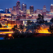 Kansas City Missouri skyline at dusk from Penn Valley Park.