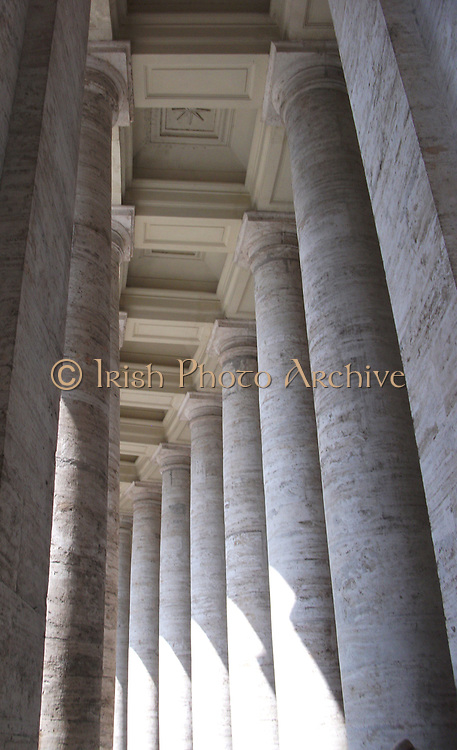 Saint Peter's Square or the Piazza San Pietro, a large plaza which stands in front of St. Peter's Basilica in the Vatican City, Italy. Placed in the centre is a 4,000 year-old Egyptian obelisk, which was places there in 1568. The actual square was designed by Gian Lorenzo Bernini almost 100 years later. The square also has 2 matching granite fountains, constructed by Carlo Maderno around 1613 and Bernini in 1675. This image shows the multitude of columns.