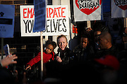 Mark Duggan's aunt, Carole speaks from the steps of Tottenham Police Station at a vigil after a jury returned a verdict of 'lawful killing'.<br />