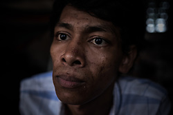 An addict in a slum, Phnom Penh, Cambodia.<br />