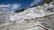 Climate | Albedo | Rhone: Huge fleece blankets cover parts of the Rhone Glacier in Switzerland in an attempt to stall the inevitable melting of the snow and ice. After a winter with record amounts of snow, most of it was gone when this image was taken on July 14th 2018, exposing the darker ice. While snow is a brilliant reflector of the energy from the sun, the darker ice absorbs the energy instead, accelerating the melting of the glacier. The color and darkness of glacier ice vary all over the world, depending on build-up of pollution, age of the ice, particles picked up by the ice and by microorganisms in the ice. The glacier ice is however rarely white as snow. With shorter winters and vanishing snow cover, the melting of the glaciers is accelerating.<br /> <br /> The Rhone Glacier (pictured) now melts more than 70 centimeters in thickness every week in the summer months. Between 1996 and 2006, an estimated 0.9 billion cubic metres of water melted yearly from the Swiss glaciers. That number is likely much higher today. Switzerland just had the hottest July since 1864, it has the lowest rainfall since 1921, and the rivers are running at record low levels. The covering of the glacier is the idea of Philipp Carlen, who owns and operates an ice cave at the mouth of the glacier. The glacier is still melting, but by covering it with blankets, he is able to attract tourists who are coming to see the dying glacier.