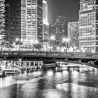 Chicago River and North Dearborn Street Bridge at night panorama photo in black and white.  Panorama photo ratio is 1:3.
