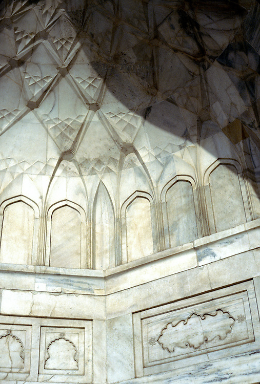 Detail of stalagtite marble in one of the niches on the exterior of the Taj Mahal.