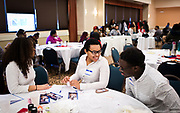Students share a laugh during the Black Excellence Youth Conference at the Best Western Plus Inntowner on Monday, Jan. 15, 2018.