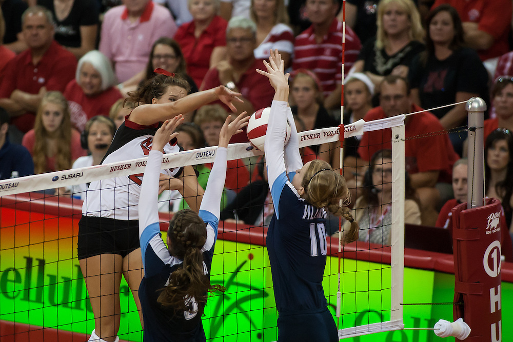 September 6, 2013: Kelsey Robinson #23 of the Nebraska Cornhuskers spikes the ball against Carly Edwards #10 of the Villanova Wildcats in the third set at the Devaney Sports Center in Lincoln, Nebraska. Nebraska defeated Villanova three sets to one.