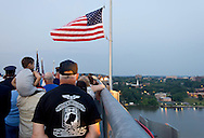 Highland, New York - People watch a Memorial Day ceremony at the center of the Walkway over the Hudson on May 27, 2012. The Hudson River and the Poughkeepsie waterfront are visible in the background at right.